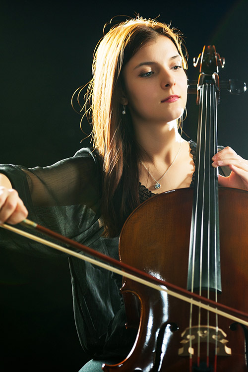 Cellist performing on her cello