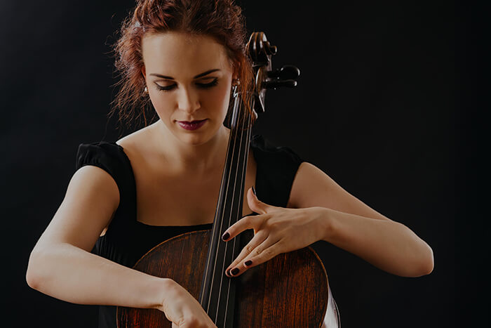 Lady learning cello