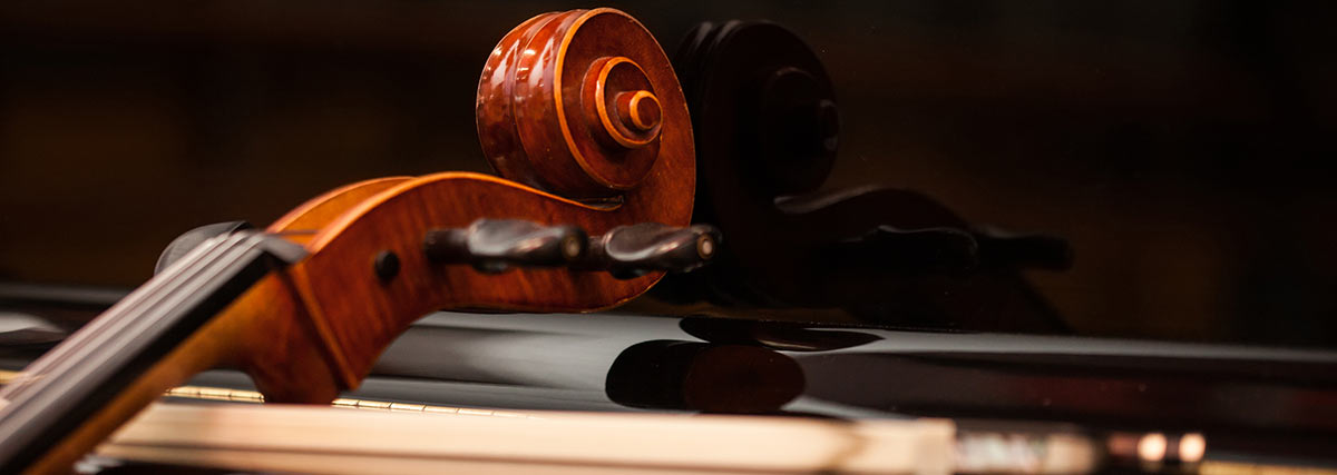 cello-scroll-and-bow-on-the-piano-pid