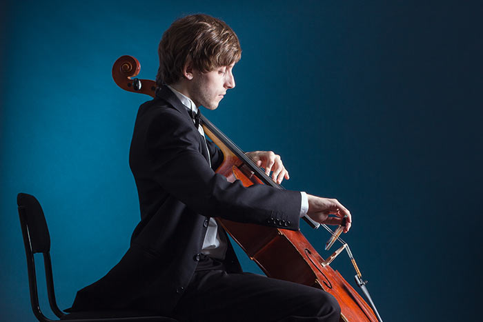 man playing the cello feat